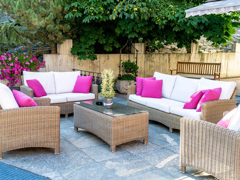 Replacement outdoor cushions for an outdoor  wicker furniture suite