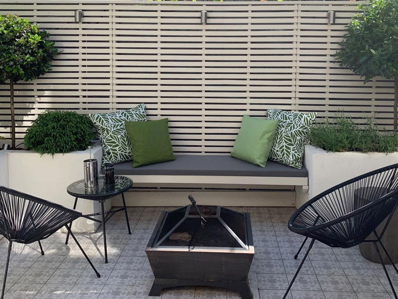 Bespoke Outdoor seat and scatter cushions for a courtyard seating area with a firepit