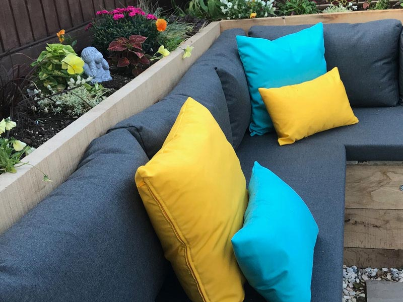 Re-covered seat cushions for a garden dining/lounge area