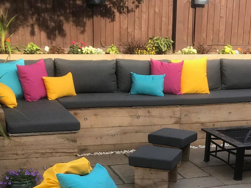 Recovered outdoor cushions for an exterior wicker furniture suite