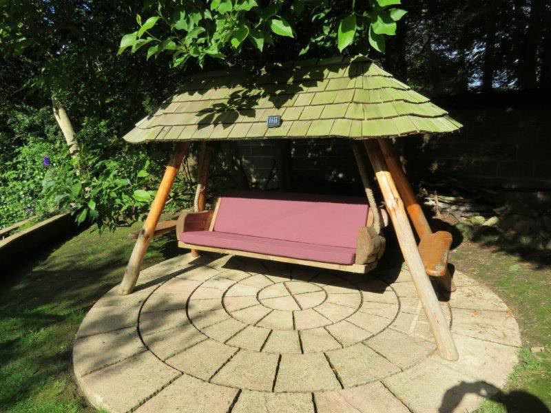 Bespoke coutdoor seat and backrest cushions for a custom garden swingchair/swingbed
