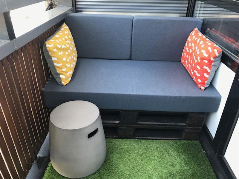 Bespoke Outdoor seat cushions and outdoor scatter cushions for a courtyard garden fixed seating area