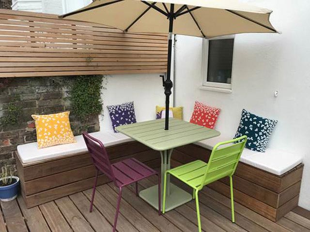 An outdoor corner seating area is completed with our bespoke outdoor cushions