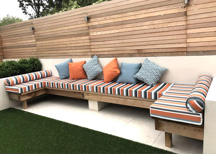 Bespoke co-ordinating outdoor seat and scatter cushions for a custom-built garden seating area