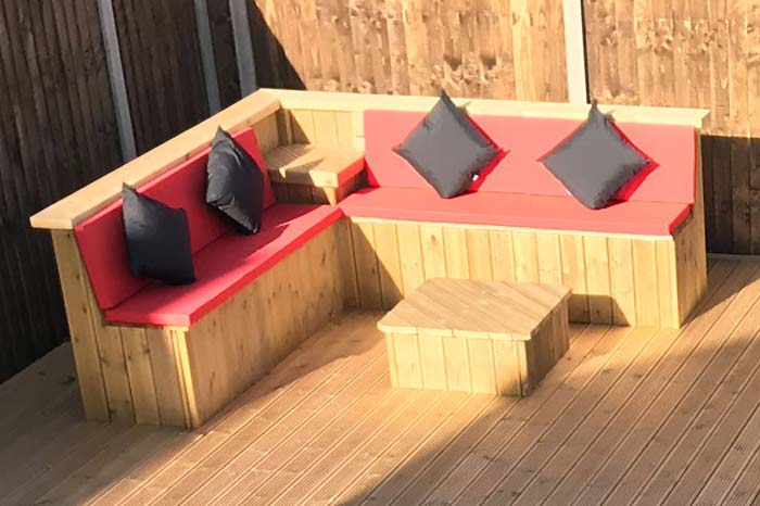 Outdoor seat cushions for a wooden picnic table