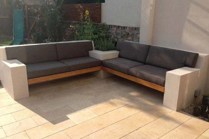 Bespoke outdoor sun and waterproof seat and backrest cushions for a custom-built garden seating area