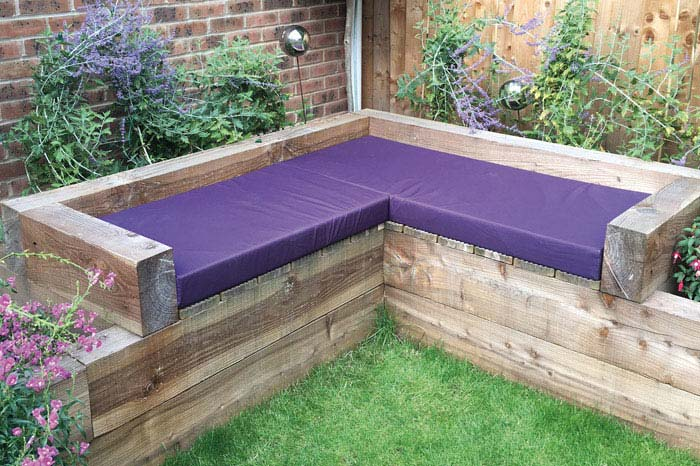 Bespoke Outdoor cushions for a timber-built corner garden seating area