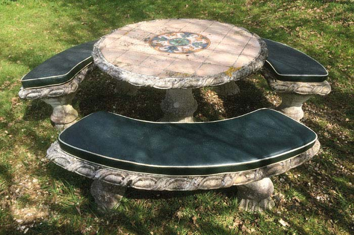 Shaped outdoor cushions for a stone table and seating set