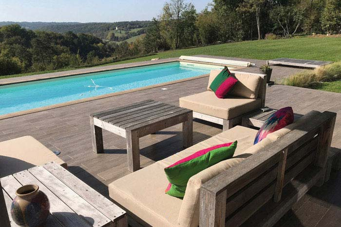 Bespoke outdoor waterproof seat cushions and fibre filled backrests for a poolside seating area